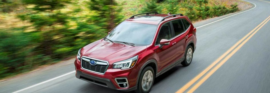 The 2018 Subaru Forester crossover driving down the road.