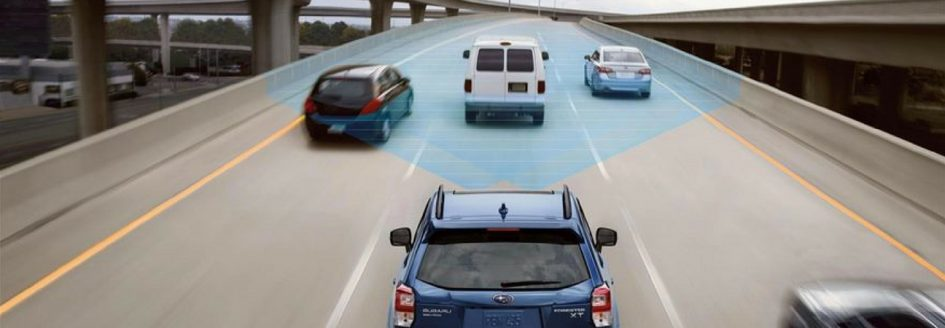 Subaru displaying EyeSight technology behind 3 cars on the freeway