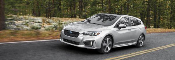 2019 Subaru Impreza driving down the road